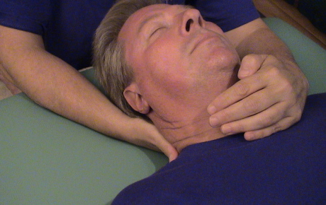 Man receiving Reiki treatment