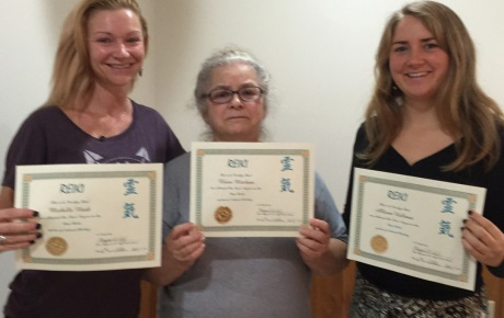 Women with their Reiki certificates